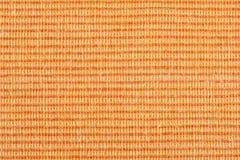 Orange striped fabric background. Orange striped fabric as background Stock Photography