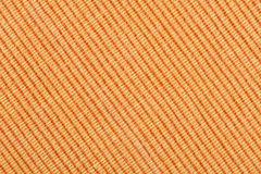 Orange striped fabric background Stock Image