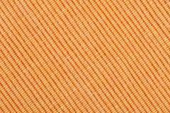 Orange striped fabric background. Orange striped fabric as background Stock Image