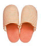 Orange striped slippers isolated on white background. Close up, high resolution Royalty Free Stock Photos