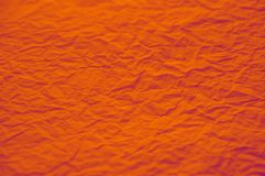 Orange Strongly rumpled paper texture stock photo