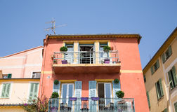 Orange Stucco Home with Blue Shutters Stock Images