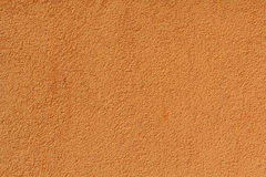 Orange stucco relief on the wall of the house Royalty Free Stock Photography