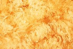 Orange stucco texture Stock Photography