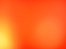 Orange suddig bakgrund Arkivbild
