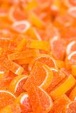 Orange sugar candy pile on street market Stock Image