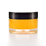 Orange sugar lip scrub on white. Royalty Free Stock Photography