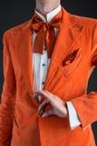 Orange suit orange bow tie Stock Photos