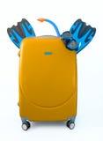 Orange suitcase packed to Vacation isolated on white. royalty free stock image