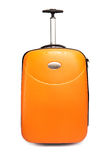 Orange suitcase for travel. Close up on a white background Royalty Free Stock Photos