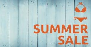 Orange summer sale text and bikini graphic against blue wood panel. Digital composite of Orange summer sale text and bikini graphic against blue wood panel Stock Photography