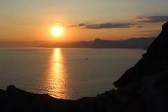 Orange summer sunset at the seaside in Crimea, Ukraine.  Royalty Free Stock Photography