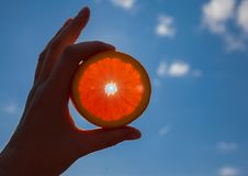 Orange sun in the hands. Orange sun in hands blue sky clouds hand rays weather clear stock photos