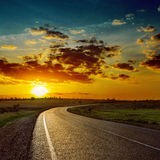Orange sun over asphalt road Royalty Free Stock Photo