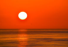 Orange Sun Skies Over the Calm Waters of the Gulf.  stock photo
