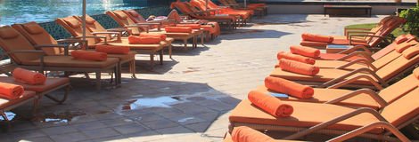 Orange sunbeds at a luxury resort Stock Photography