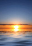 Orange sundown. The orange sundown on smooth to sea water Royalty Free Stock Photo
