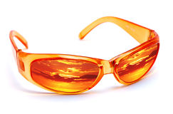 Orange Sunglasses. Reflecting sunset on a white background Stock Images