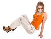 Orange sunglasses. The girl in the orange t-shirt, white jeans and orange sunglasses Stock Photography