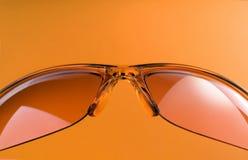 Orange Sunglasses. Over orange background Royalty Free Stock Photos