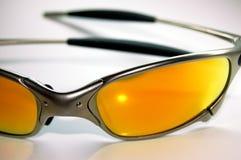 Orange sunglasses. Silver sunglasses with orange lenses stock photo