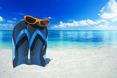 Orange sunglasses and flip flops Royalty Free Stock Photography
