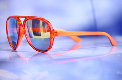 Orange sunglasses with golden glasses Stock Photo