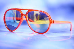 Orange sunglasses with golden glasses Royalty Free Stock Image