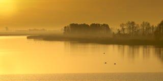 Orange sunrise Lauwersmeergebied Stock Photo