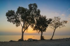 Orange sunrise over the mediterranean sea coast royalty free stock images