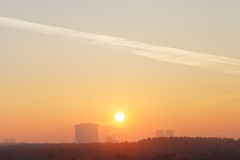Orange sunrise sky over city in cold winter Royalty Free Stock Images