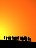 Orange sunset. Silhouettes of young children in orange sunset Stock Photo