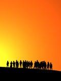 Orange sunset. Silhouettes of young children in orange sunset royalty free illustration