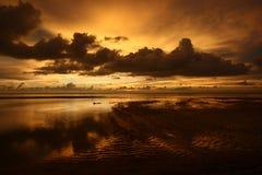 Orange sunset. An orange sunset during low tide Stock Images
