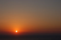 Orange sunset above the calm sea Royalty Free Stock Photography
