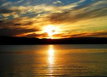 Orange sunset above a fjord royalty free stock images