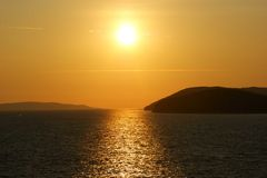 Orange Sunset in Adriatic Sea stock photos