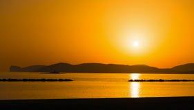 Orange sunset in Alghero shoreline Stock Photos