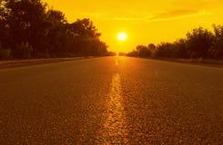 Orange sunset and asphalt road Royalty Free Stock Images