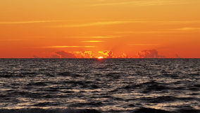 Orange and red sunset on sea Stock Photos