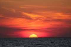 Orange sunset on the Bay. Sunset at Cape May over the Delaware Bay Royalty Free Stock Photos