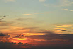 Orange sunset behind clouds Royalty Free Stock Photography