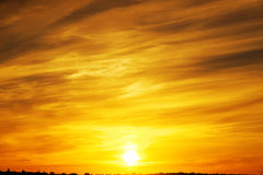 Orange sunset and clouds Royalty Free Stock Image