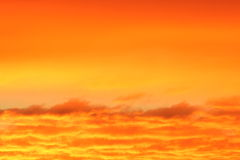 Orange sunset clouds Stock Images