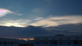 Orange Sunset in Dark Blue Cloudy Sky above City Buildings stock video