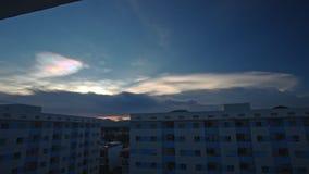 Orange Sunset in Dark Blue Cloudy Sky above City Buildings stock video footage