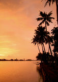 Orange sunset in Kerala, India Stock Photos