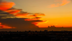 Orange sunset light over cityscape Stock Photography