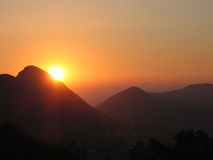 Orange sunset in the mountains. Corfu island, Greece Royalty Free Stock Photos