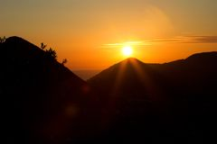 Orange sunset in the mountains Royalty Free Stock Photography